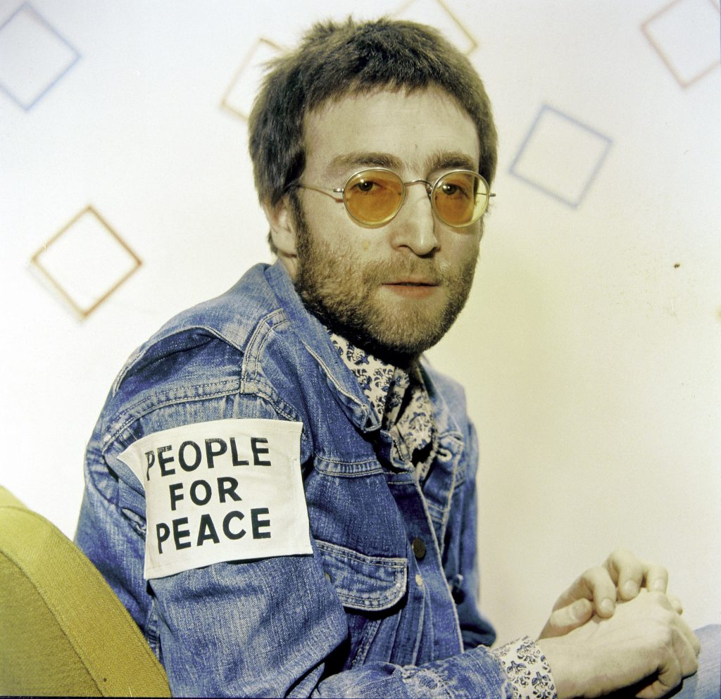 """John Lennon wearing a patch reading """"People for Peace"""""""