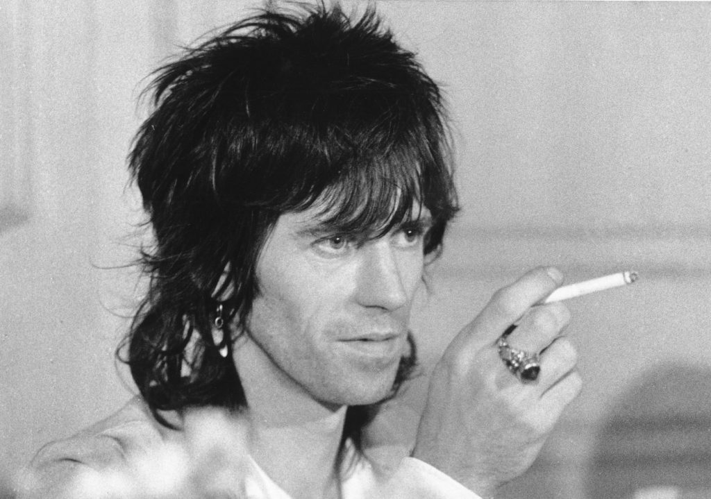 Keith Richards holding a cigarette