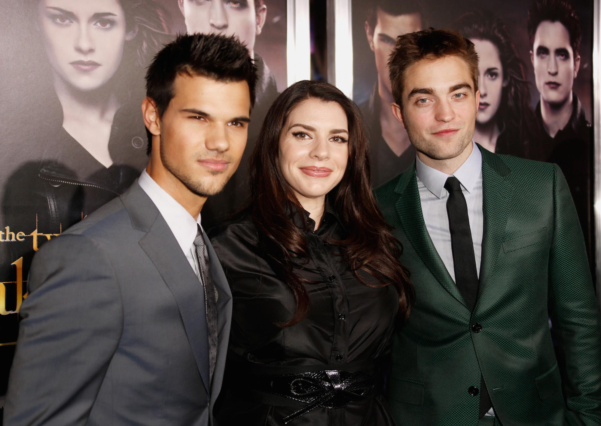 Taylor Lautner, Stephenie Meyer, and Robert Pattinson at 'The Twilight Saga: Breaking Dawn - Part 2' Los Angeles premiere on November 12, 2012.