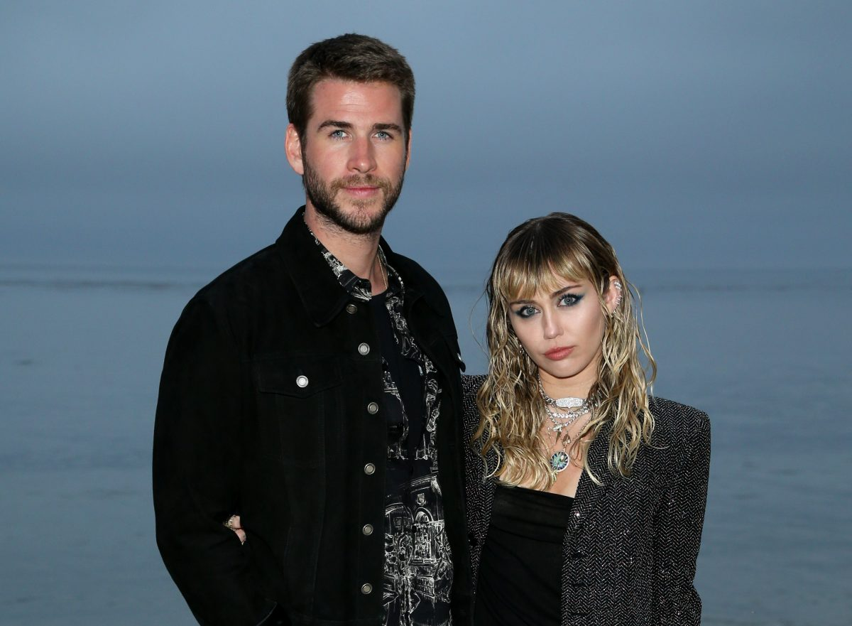 (L-R) Liam Hemsworth and Miley Cyrus attend the Saint Laurent Mens Spring Summer 20 Show on June 6, 2019 in Malibu, California.