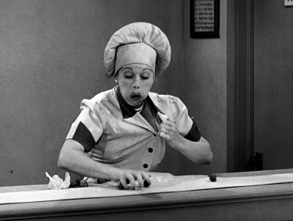 Lucille Ball wearing a hat in an episode of I Love Lucy