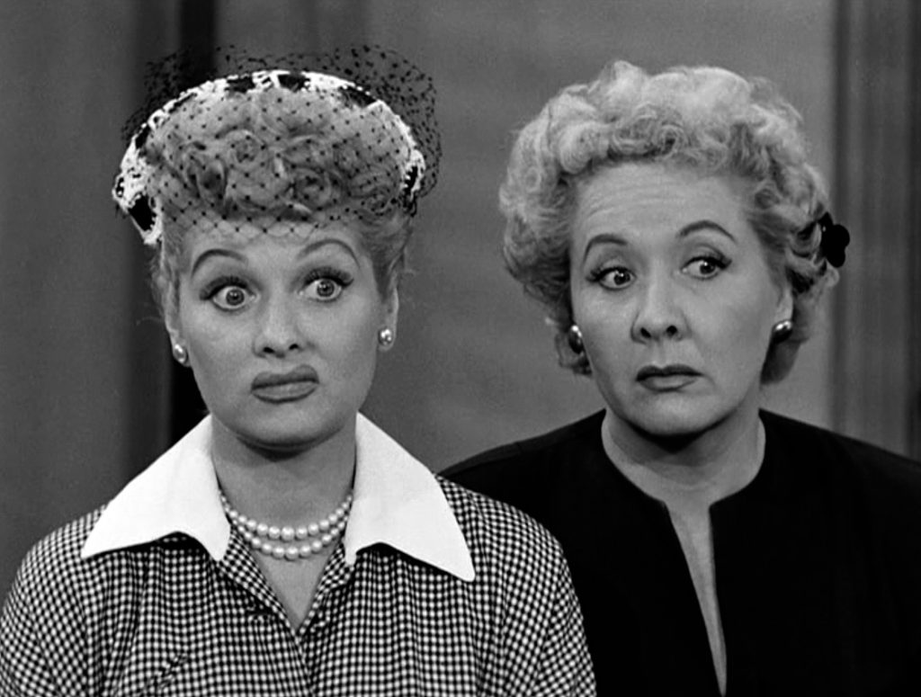 Lucille Ball and Vivian Vance in front of a wall in an episode of 'I Love Lucy'