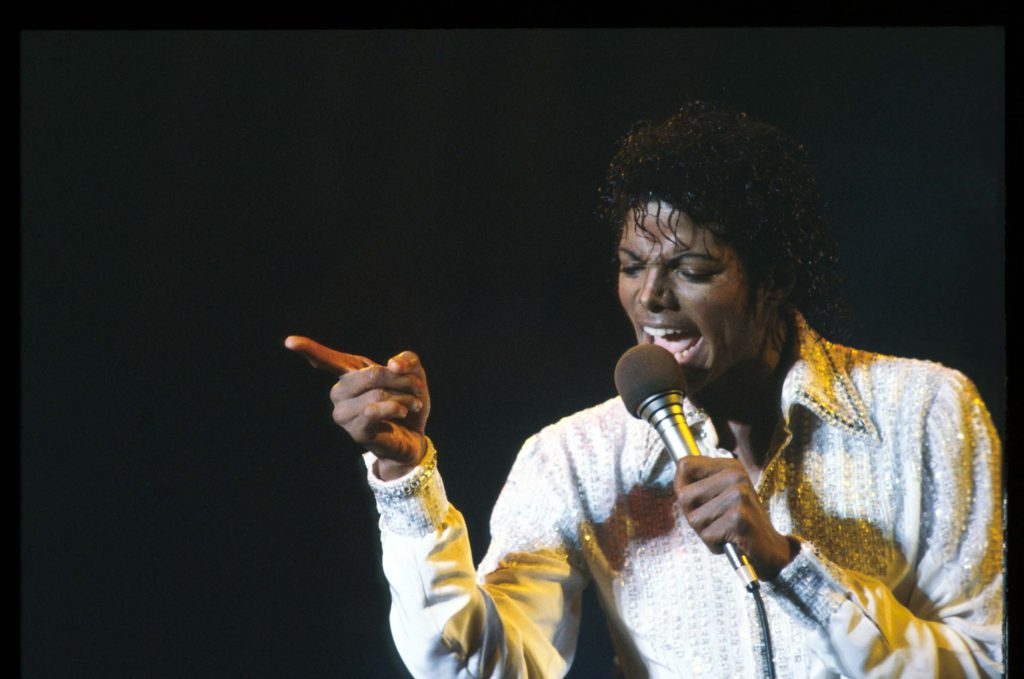 Michael Jackson holding a microphone