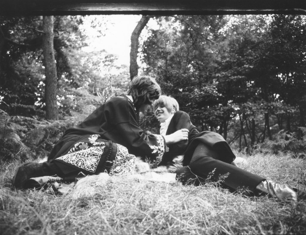 Mick Jagger and Marianne Faithfull lying in hay