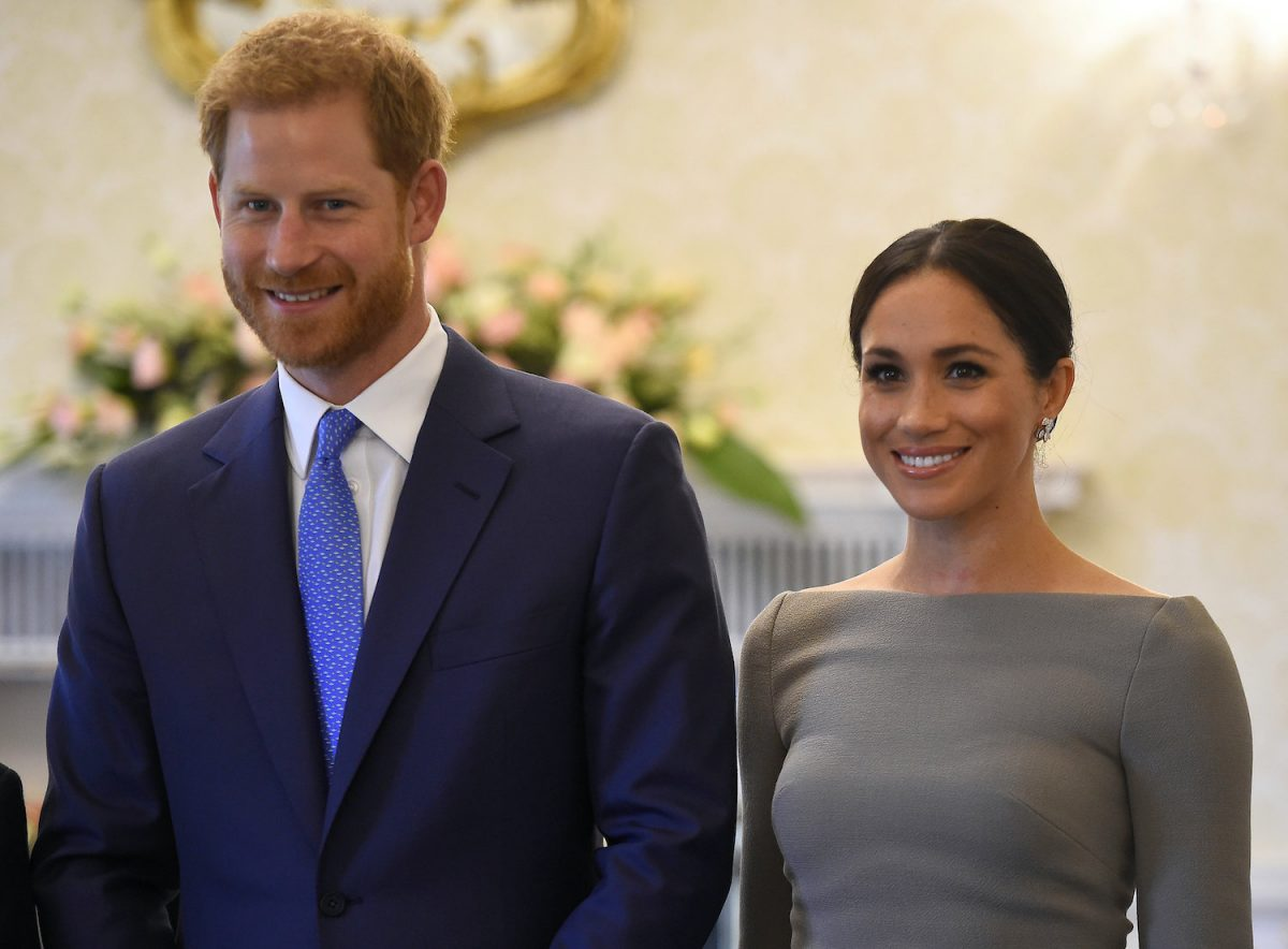 Prince Harry and Meghan Markle smile as they arrive to meet Ireland's President, Michael Higgins