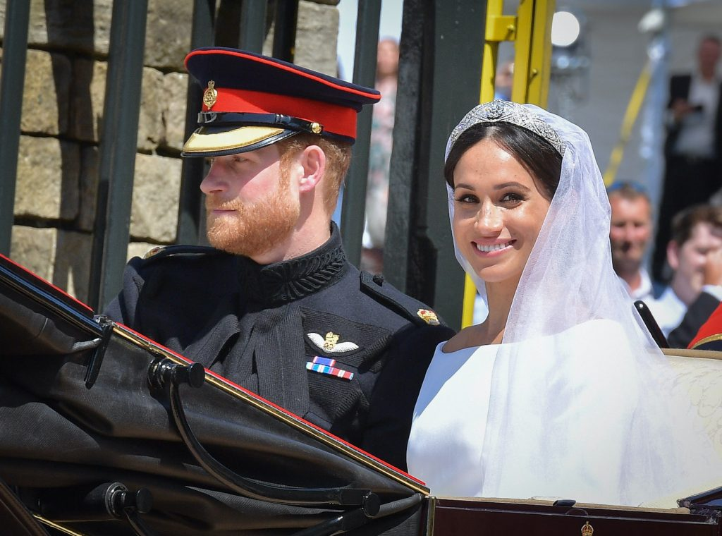 Prince Harry and Meghan Markle leave Windsor Castle in the Ascot Landau carriage during a procession after getting married