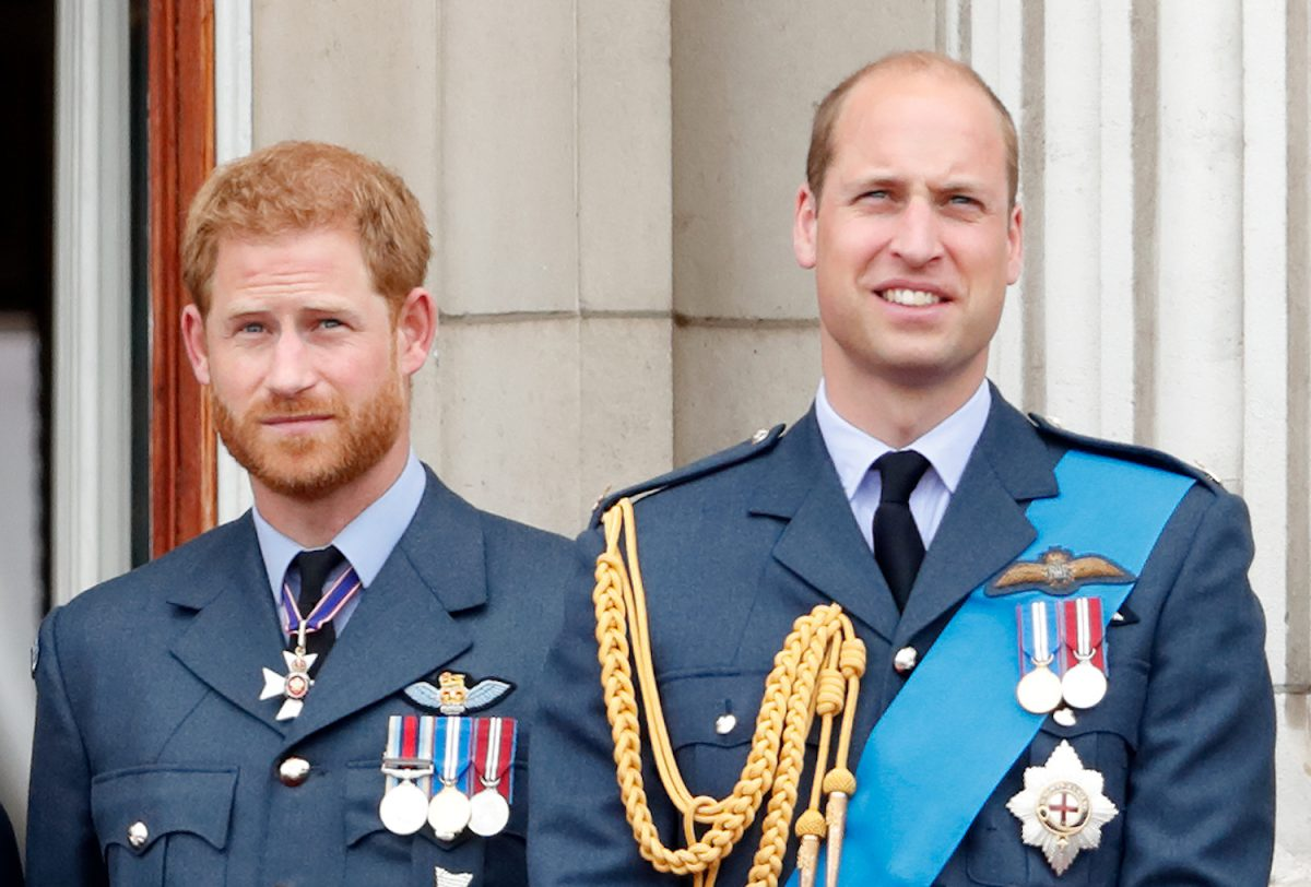 Prince Harry and Prince William watch a flypast to mark the centenary of the Royal Air Force from the balcony of Buckingham Palace