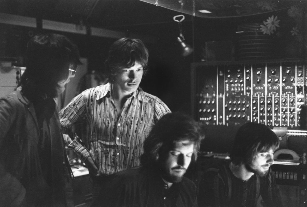 Mick Jagger and other members of The Rolling Stones near studio equipment