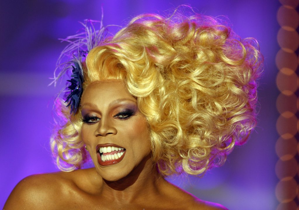 RuPaul with a purple background