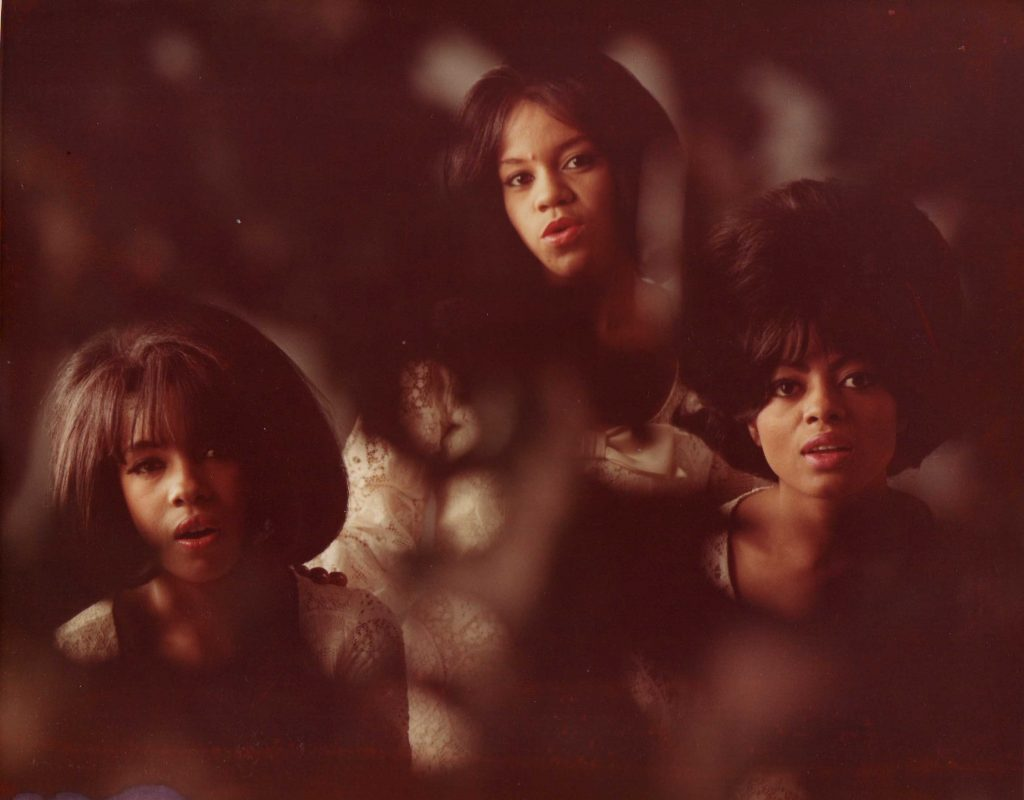 A photo of the Supremes wear something covers part of the lens