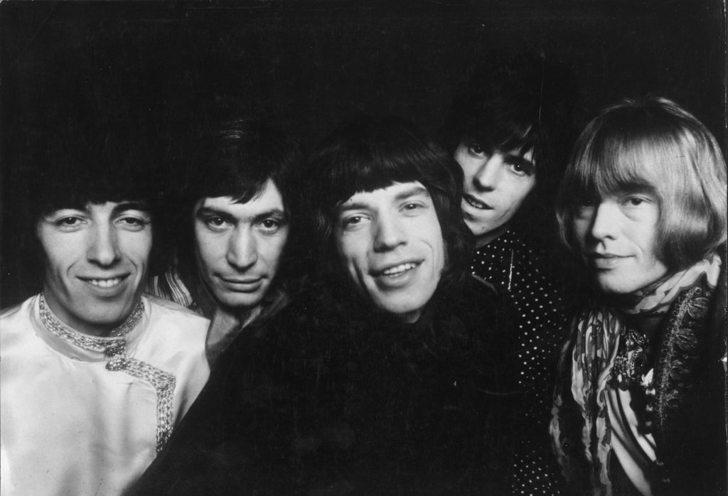 The Rolling Stones standing in a row and looking at the camera