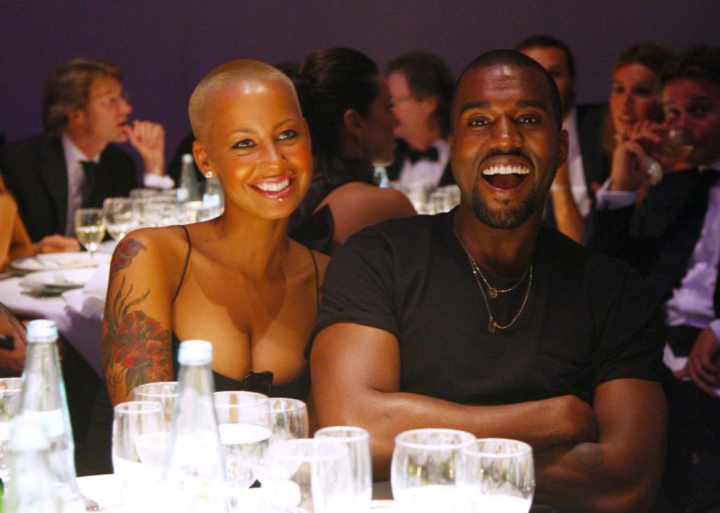Amber Rose and Kanye West attend amfAR Milano 2009 Dinner, the Inaugural Milan Fashion Week event at La Permanente on September 28, 2009 in Milan, Italy.