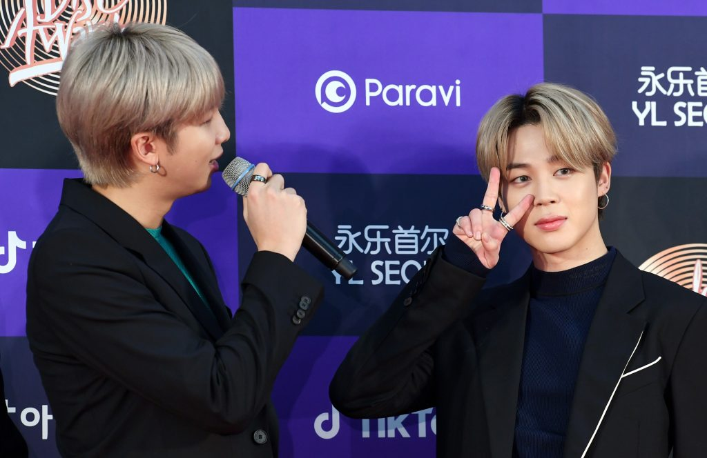 RM and Jimin of BTS arrive at the photo call for the 34th Golden Disc Awards