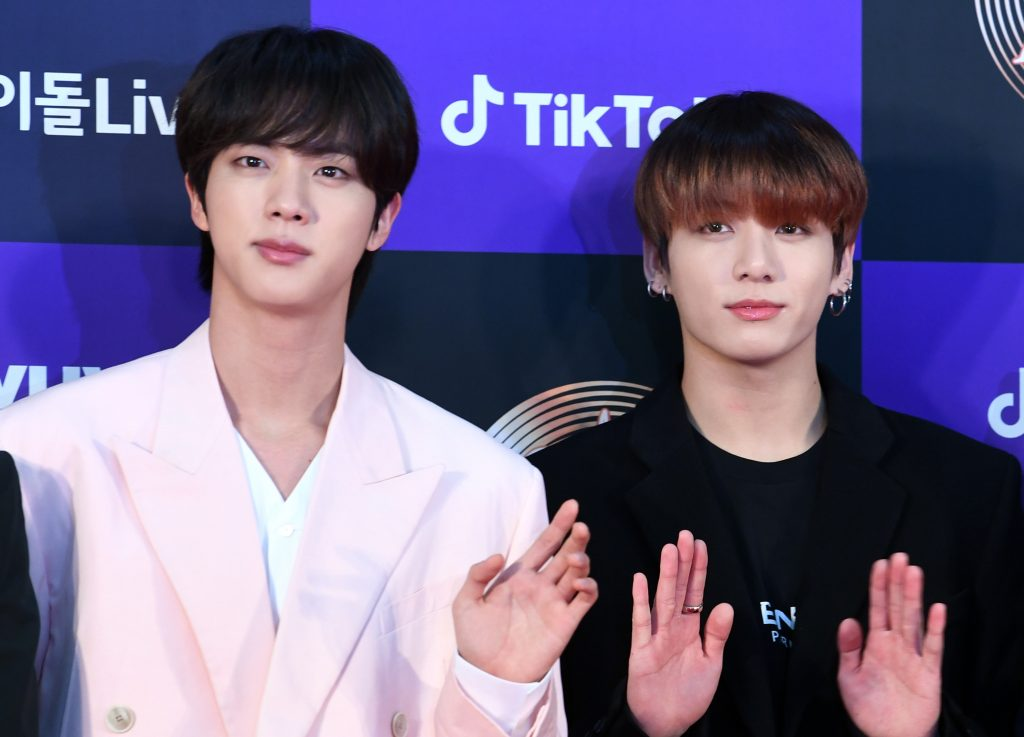Jin and Jungkook of BTS arrives at the photo call for the 34th Golden Disc Awards