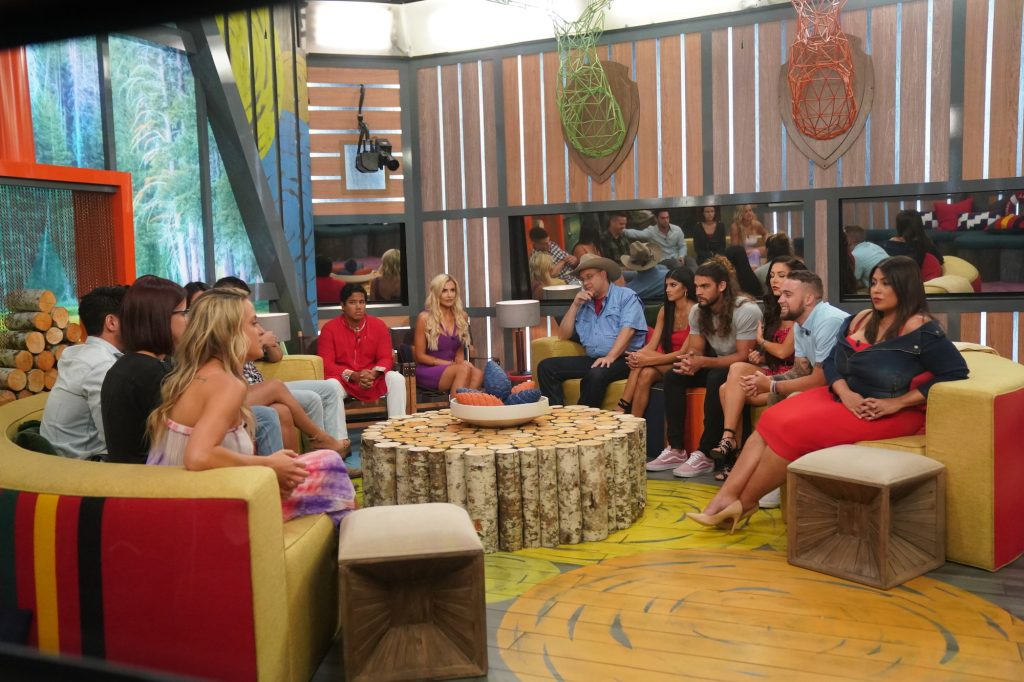 'Big Brother' cast members sitting in a circle waiting for the eviction vote