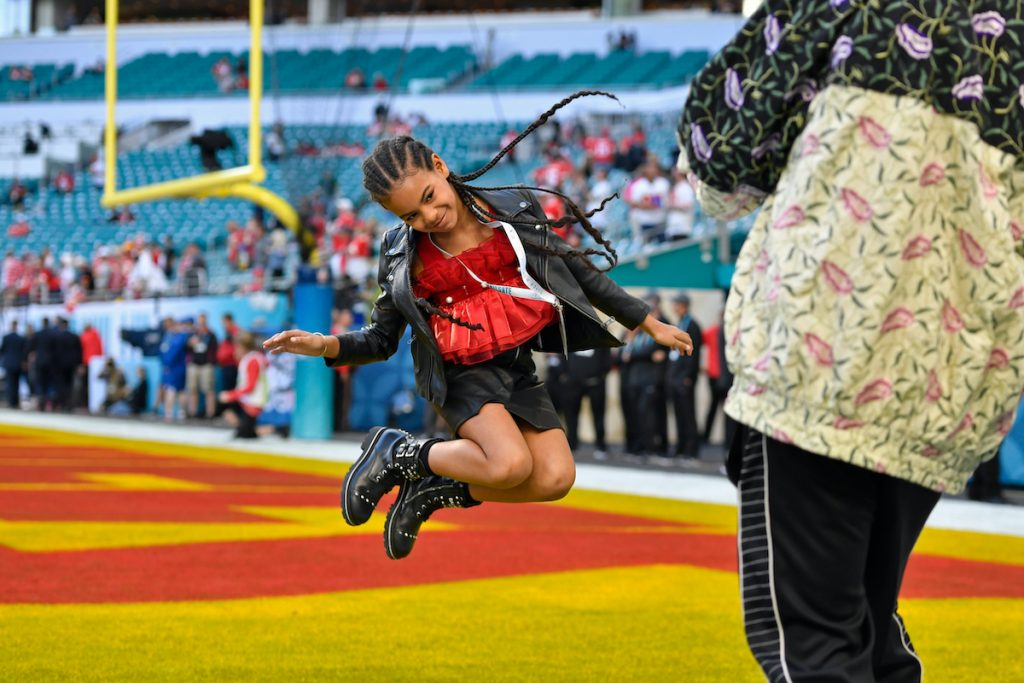 Jay-Z photographs his daughter Blue Ivy Carter as she jumps in the end zone before the start of Super Bowl LIV at Hard Rock Stadium in Miami Gardens, FL on Sunday, Feb. 2, 2020   Jose Carlos Fajardo/MediaNews Group/The Mercury News via Getty Images