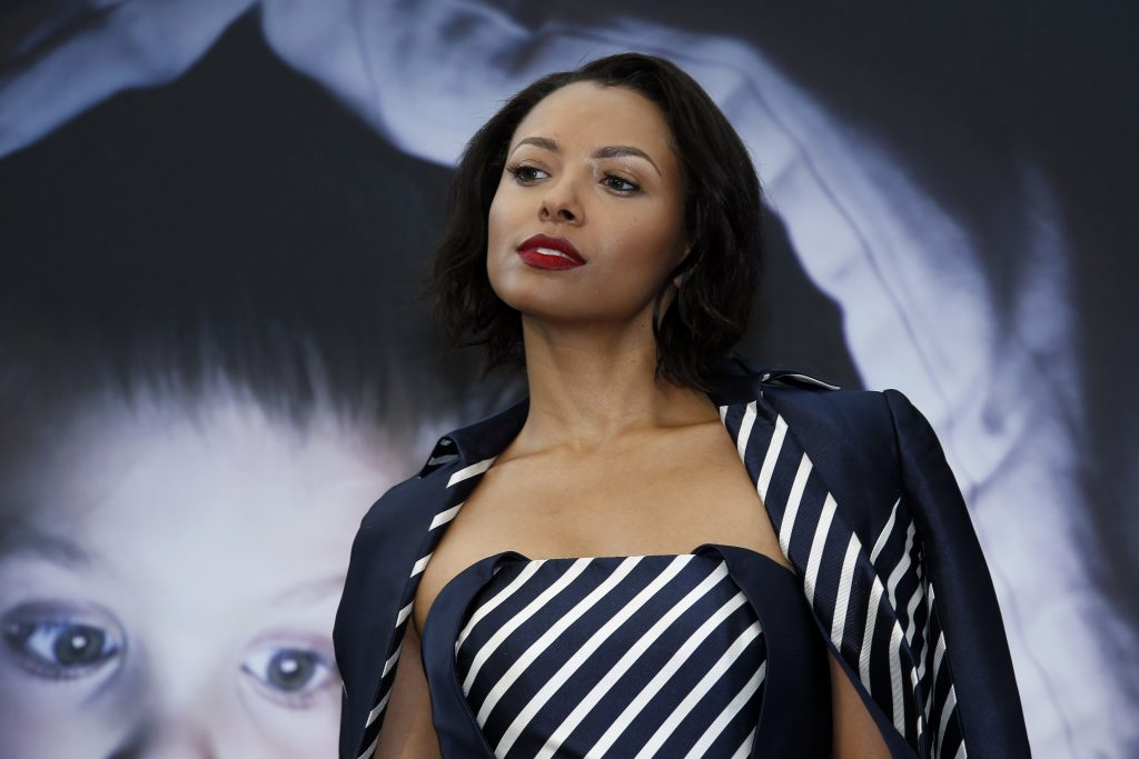 Swiss-born US actress Kat Graham poses during a photocall for the TV series, 'Vampire Diaries'