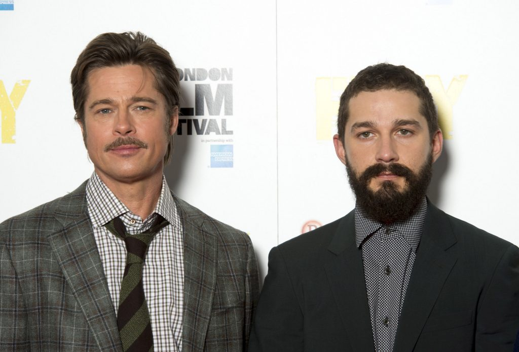 (L-R) Brad Pitt and Shia LaBeouf in front of a white background