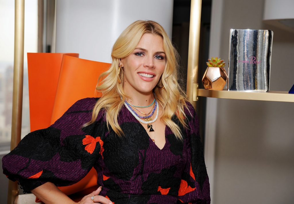 Busy Philipps smiling in front of a shelf