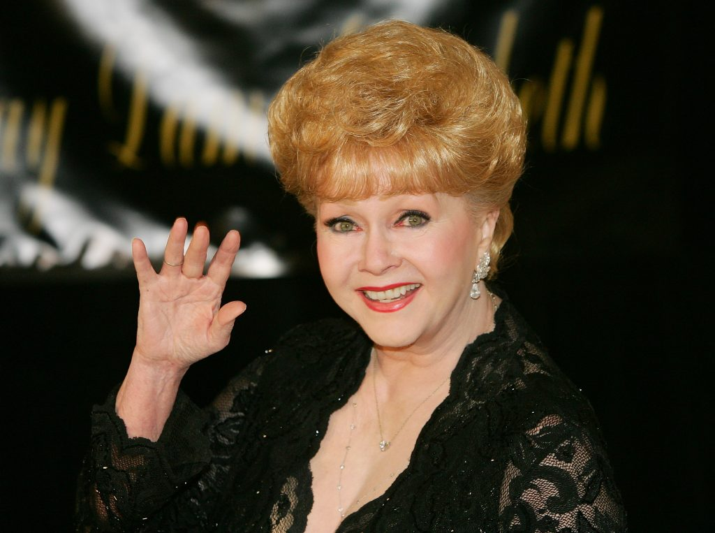 Actress Debbie Reynolds waves as she arrives for Dame Elizabeth Taylor's 75th birthday party