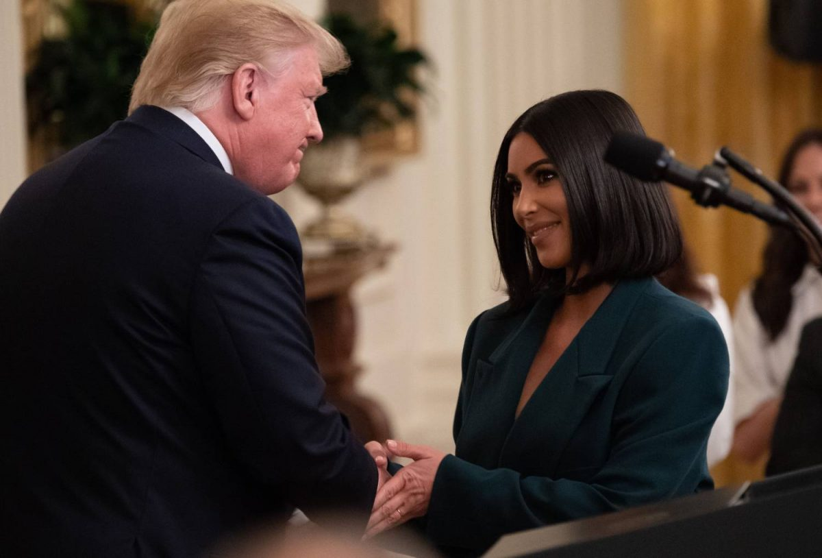 Kim Kardashian shakes hands with US President Donald Trump during a second chance hiring and criminal justice reform event in the East Room of the White House in Washington, DC, June 13, 2019.