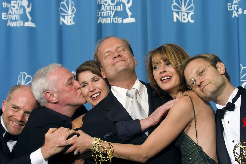 Kelsey Grammer (center) and David Hyde Pierce (R) are joined by fellow 'Frasier' cast members actors Jane Leeves, Peri Gilpin, John Mahoney and James Burrows attend the Emmy Awards in 1998