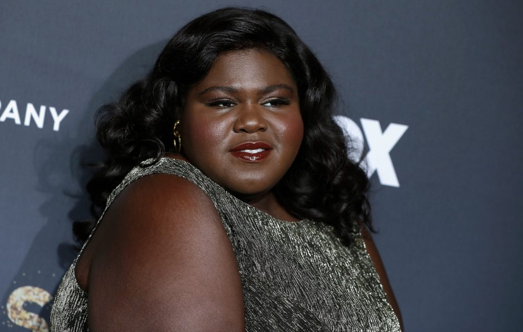 Gabourey Sidibe smiling slightly, turned to the side
