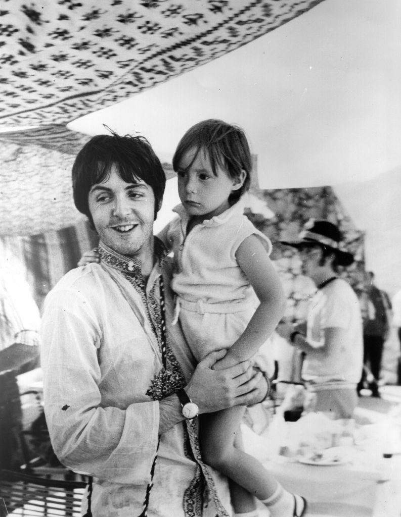 Paul McCartney with a 4-year-old Julian Lennon in Greece