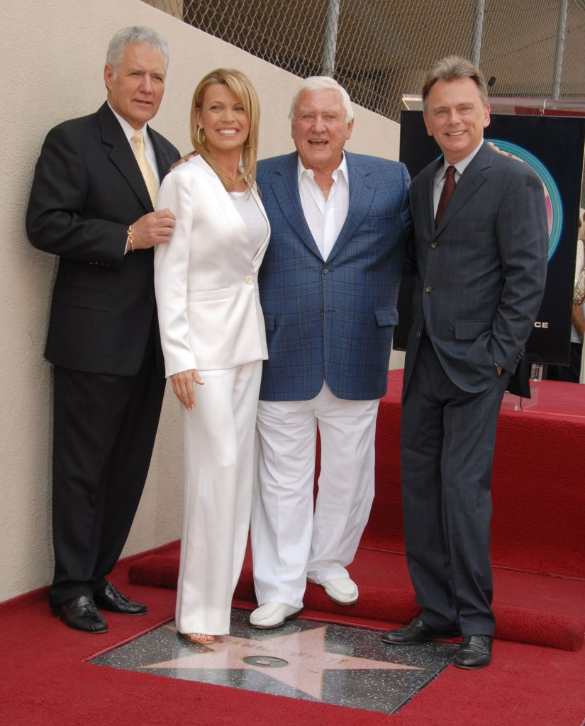 left to right: Alex Trebek, Vanna White, Merv Griffin, and Pat Sajak