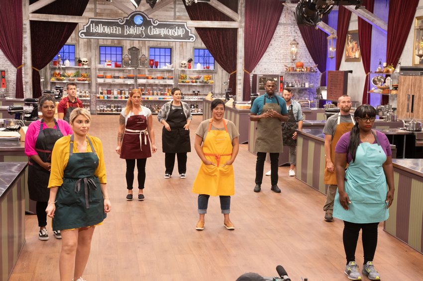Contestants on Halloween Baking Championship socially distanced from each oth