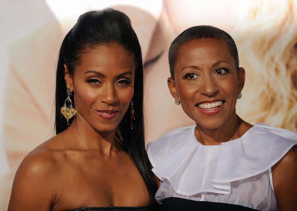 Actress Jada Pinkett Smith arrives with her mother, Adrienne Banfield (R) at the premiere of 'The Women'
