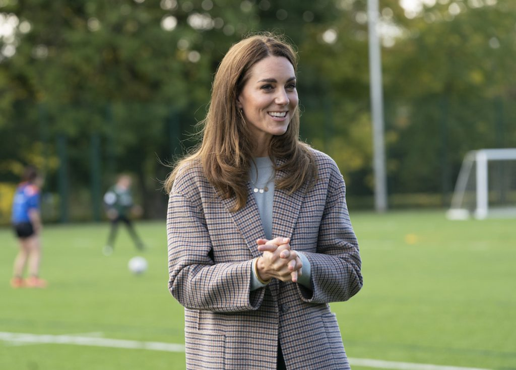 The Duchess of Cambridge visited students at the University of Derby in a checkered coat.