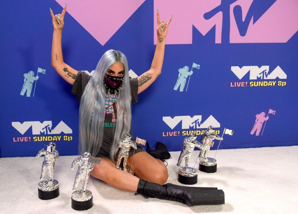 Lady Gaga poses with her awards