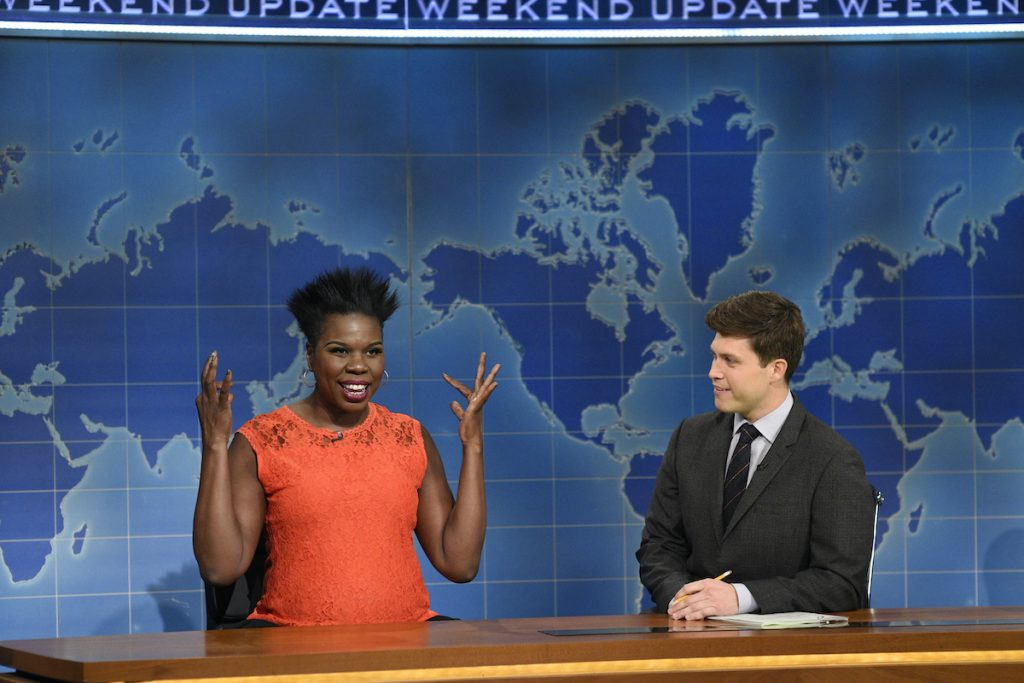 """Leslie Jones and Colin Jost during """"Weekend Update"""" on Saturday Night Live 