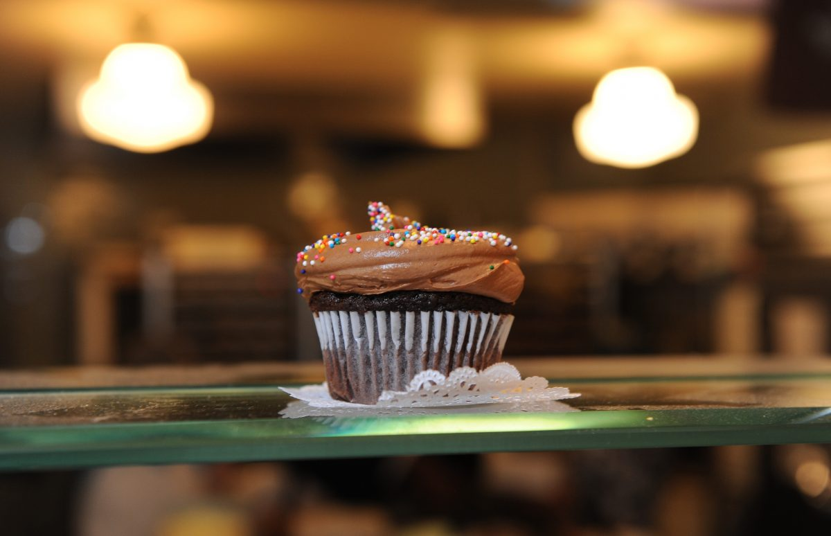 A cupcake on display at the Magnolia Bakery F