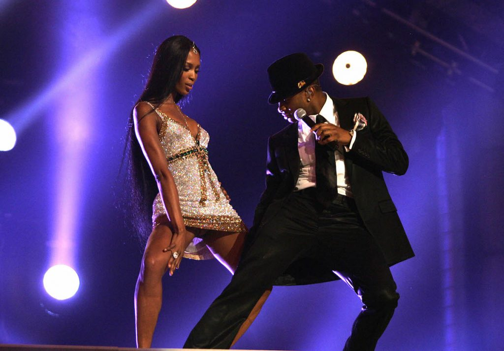 "Usher and Naomi Campbell perform onstage at the ""Fashion Rocks"" concert held at Radio City Music Hall on September 8, 2004 in New York City.  Campbell is wearing jewelry by Garrard"