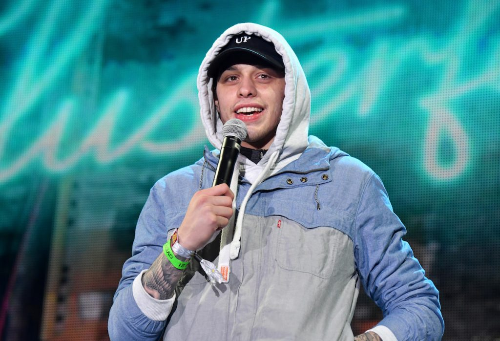 Pete Davidson performs on stage.