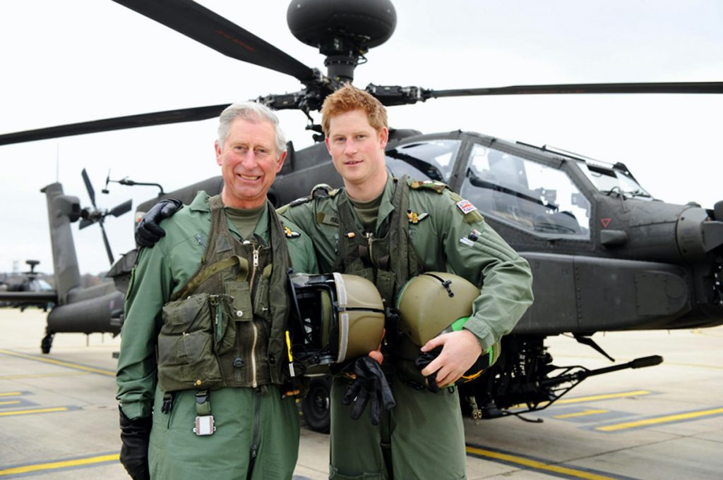 Prince Harry and his father, the Prince Charles, Prince of Wales, stand in front of an Apache Helicopter after Prince Charles was invited by the Army Aviation Centre in his role as Colonel-in-Chief of the Army Air Corps (AAC) in order to fly an Apache and to meet students on the Apache Conversion Course on March 21, 2011 in Middle Wallop, England. The announcement by St James's Palace comes a few days after the royal, a trainee Apache helicopter pilot, passed the half-decade milestone