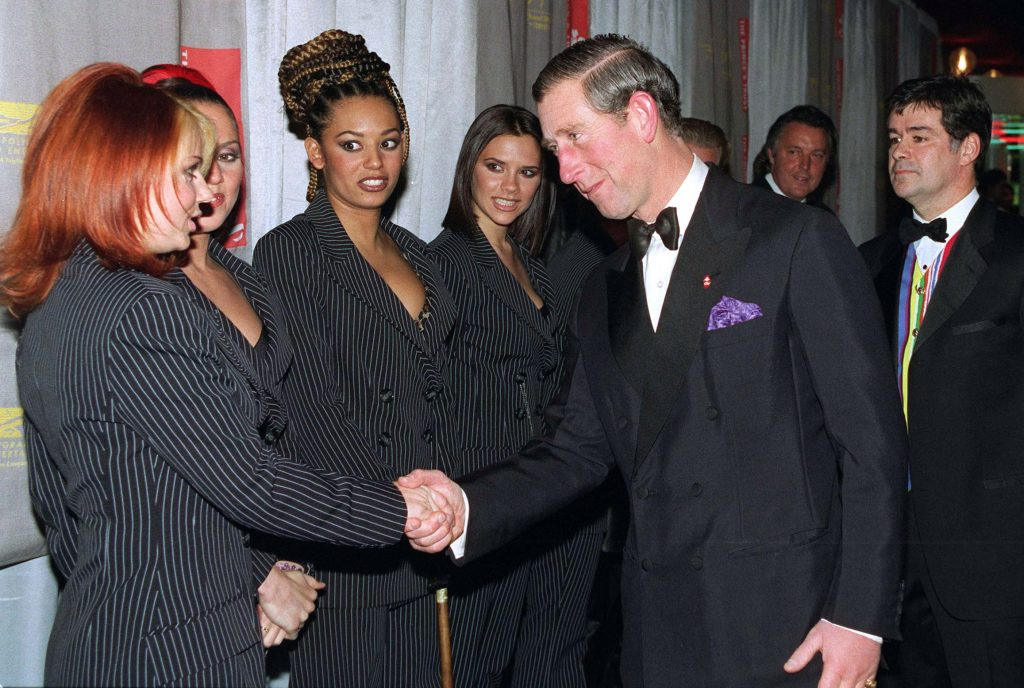 Prince Charles shaking hands with Geri Halliwell and other Spice Girls