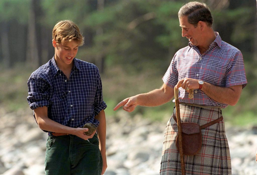 Prince Charles With Prince William In Open-necked Shirts At Polvier By The River Dee, Balmoral Castle Estate