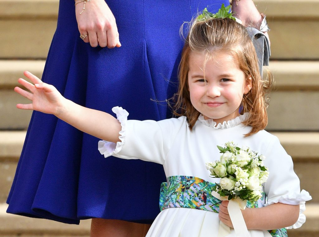 Princess Charlotte of Cambridge attends the wedding of Princess Eugenie of York and Jack Brooksbank at St George's Chapel on October 12, 2018 in Windsor, England