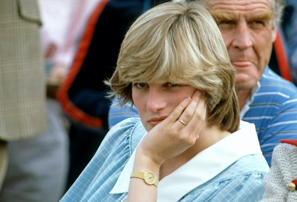 Diana, Princess of Wales, wearing a a pale green maternity dress with a white collar by Catherine Walker, while pregnant with Prince William, attends a Polo match on May 15, 1982 in Hampshire, United Kingdom