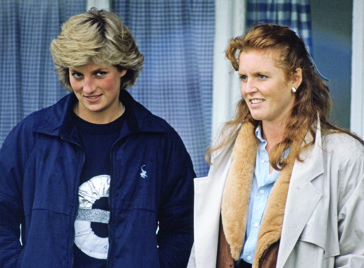 Princess Diana and Sarah Ferguson stand next to each other at a polo match