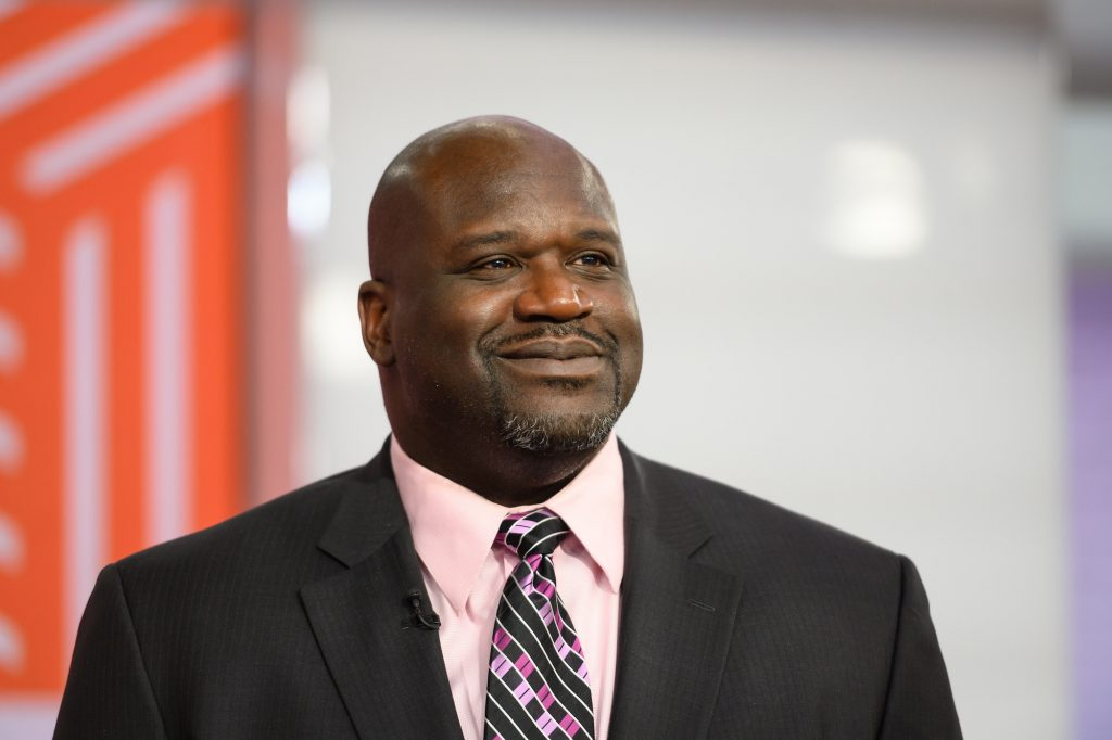 Shaquille O'Neal smiling, looking to the right