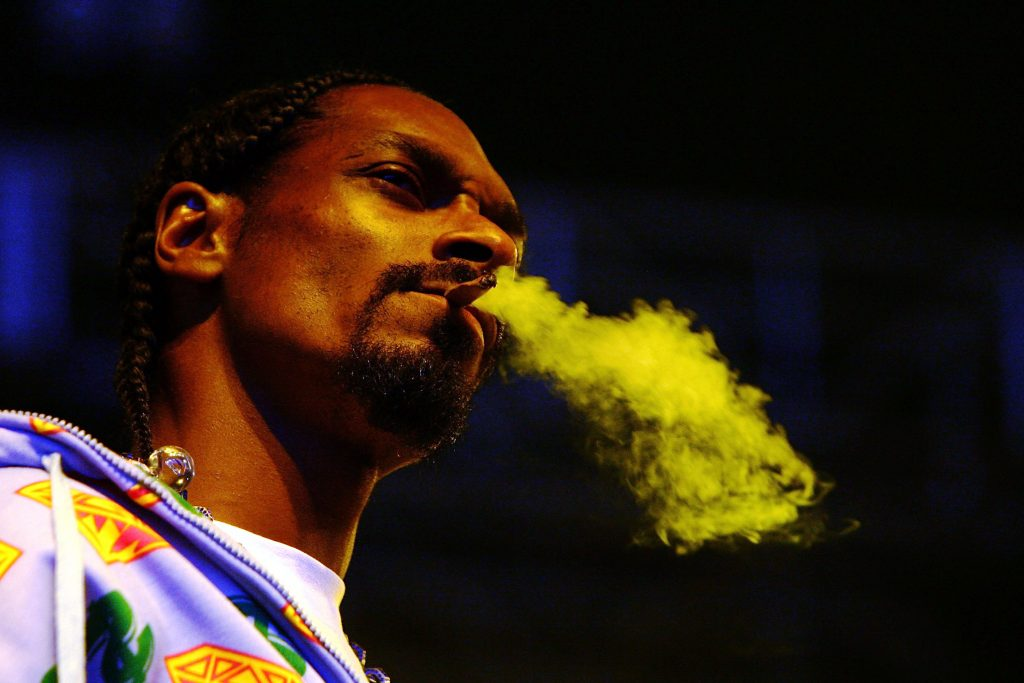 Rapper Snoop Dogg smokes while performing at the Melbourne stop of the Good Vibrations Festival 2007 in Melbourne, Australia | Kristian Dowling/Getty Images