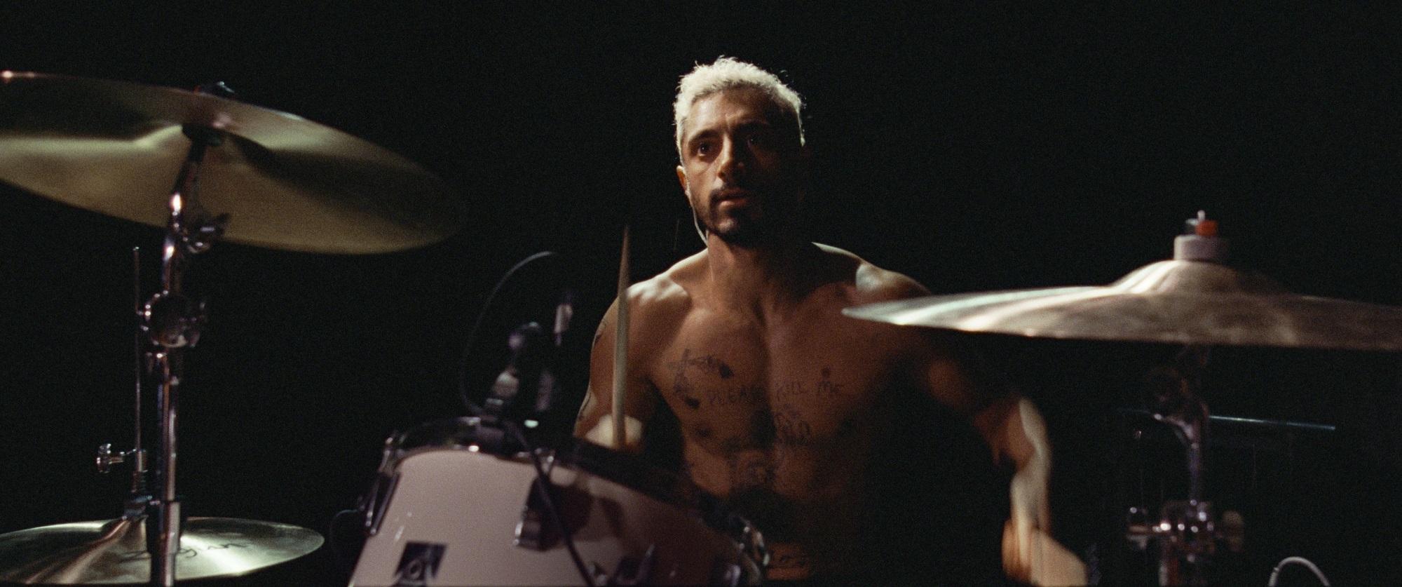 Riz Ahmen playing drums