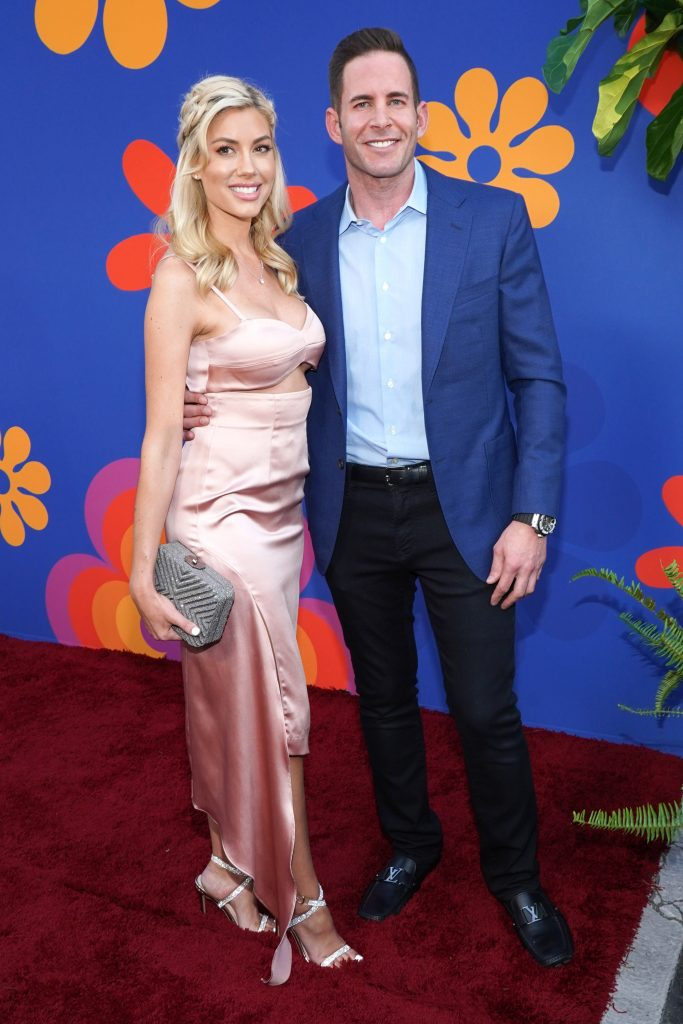 Tarek El Moussa (R) and Heather Rae Young attend the premiere of HGTV's 'A Very Brady Rennovation'