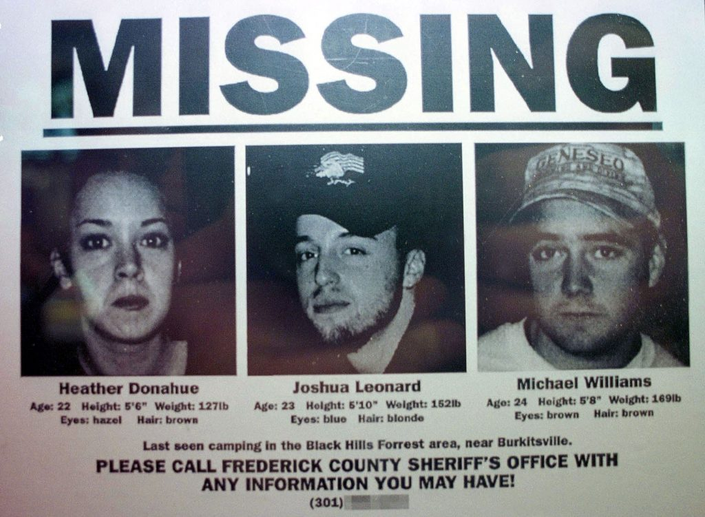 """One of the Blair Witch Project """"artifacts"""", a missing poster, features the three actors who starred in the film, from left, Heather Donahue, Joshua Leonard and Michael Williams, on display"""