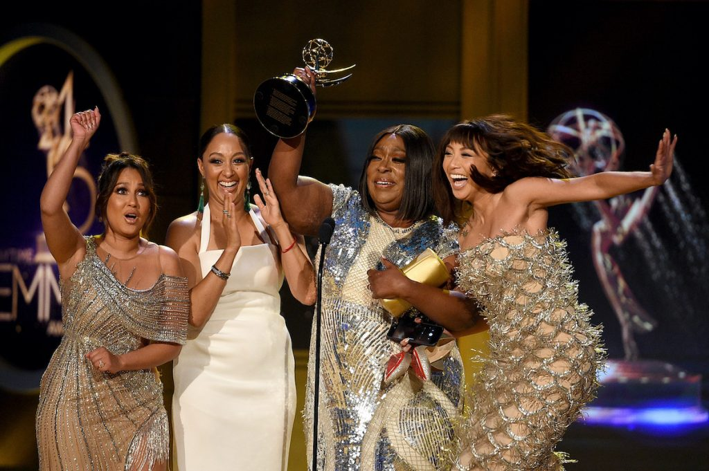 (L-R) Adrienne Bailon, Tamera Mowry-Housley, Loni Love, and Jeannie Mai, winners of Outstanding Entertainment Talk Show Host for The Real, accept award onstage during the 45th annual Daytime Emmy Awards