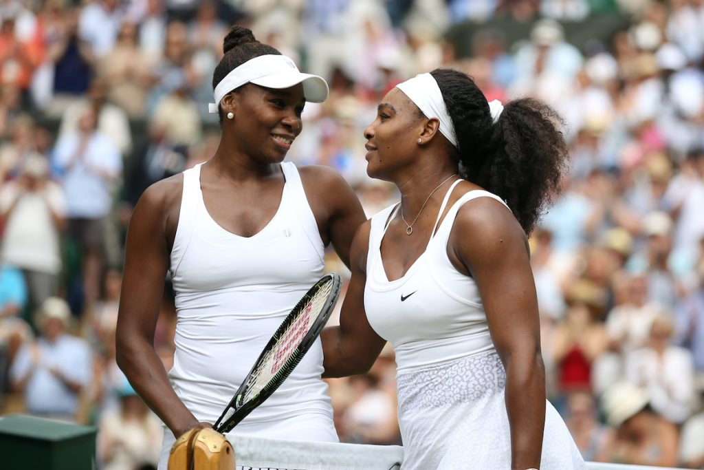 Venus Williams embraces sister Serena after defeat in the 4th round on day 7 of the Wimbledon Lawn Tennis Championships | Marc Atkins/Mark Leech/Getty Images